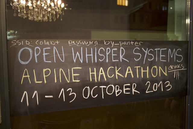 A sign reads: Open Whisper Systems Alphine Hackathon 11-13 October 2013