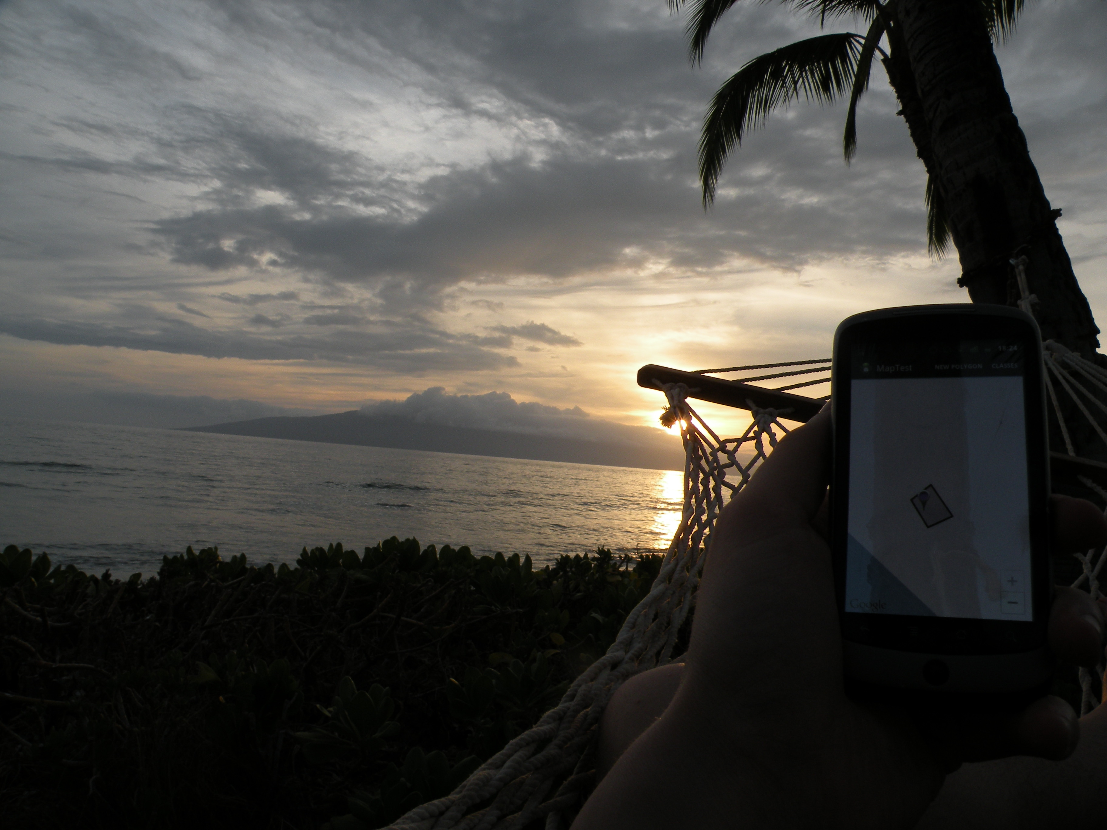 Demo from hammock of geofencing on Android with sunset int he background.