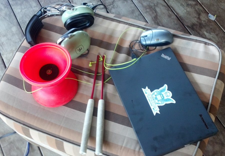 A laptop, headset, and diabolo.