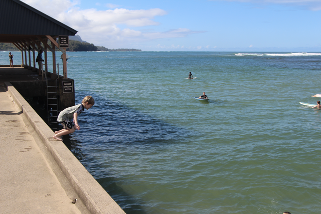 Jumping off the pier at Hanalei Bay